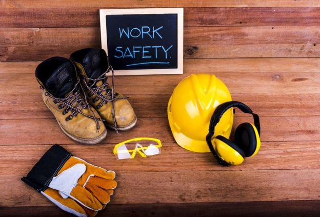 collection of work equipment with chalkboard saying work safety