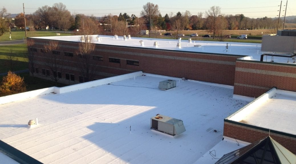 Commercial roof with elastomeric coating installed by Heidler Roofing